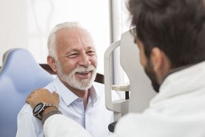 Older male patient with eye doctor.