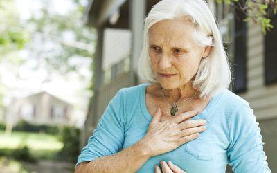 A woman suffering from heartburn.