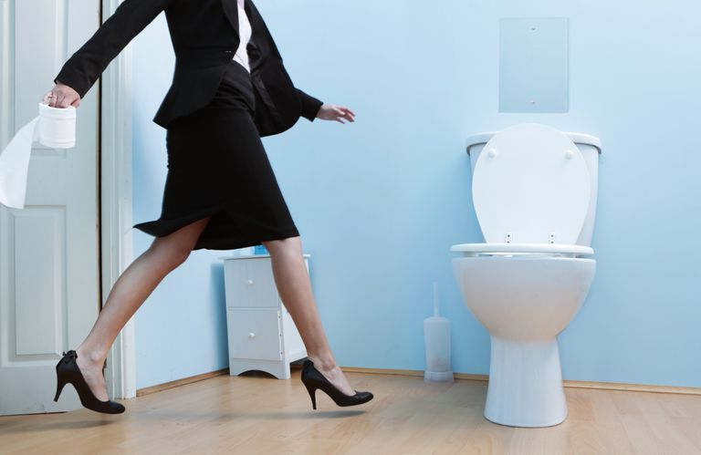 Photo of a woman running to the toilet
