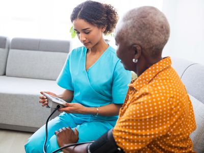 Nurse checking blood pressure for person taking losartan for high blood pressure