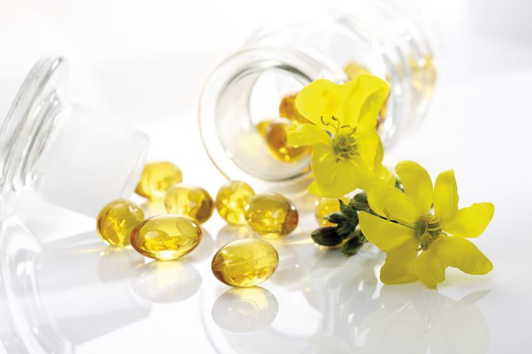 Evening primrose oil capsules and flowers
