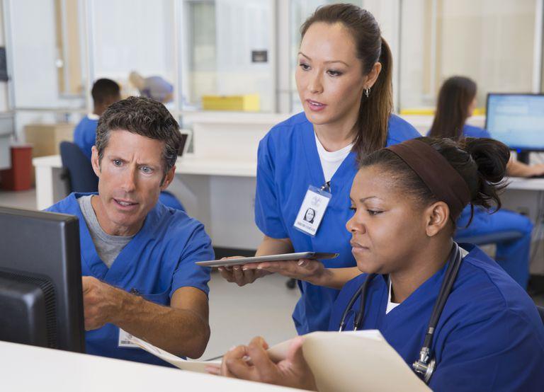 nurses at hospital looking at computer