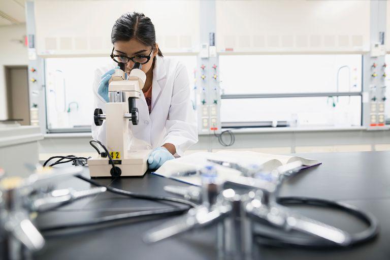 A scientist using a microscope in laboratory.