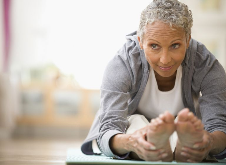 Older woman stretching doing yoga