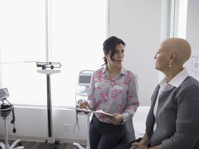 A doctor and her patient talking in examination room