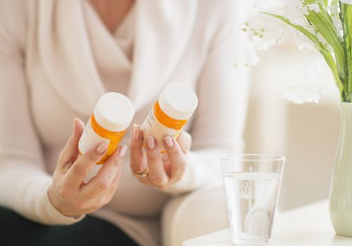 A woman looking at her medication