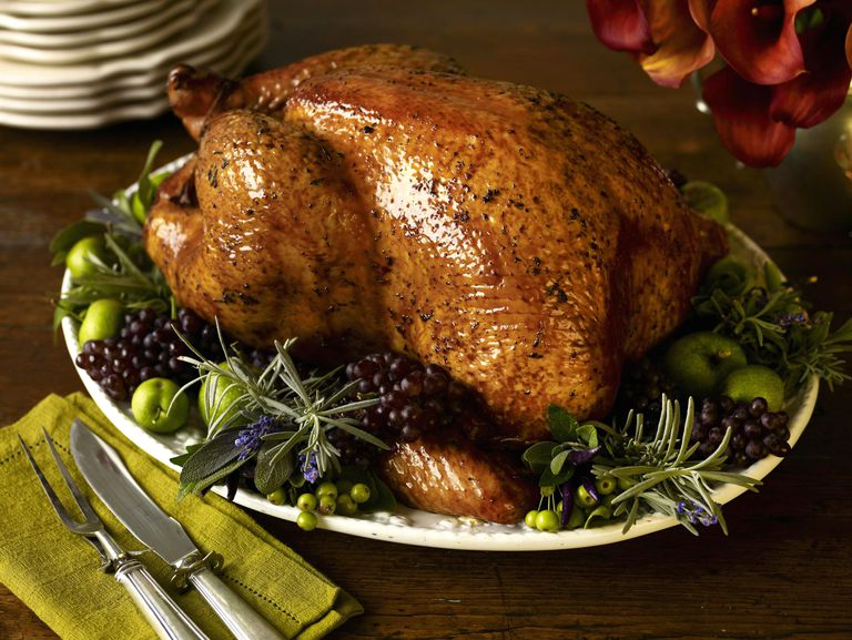 A baked turkey on a wooden table