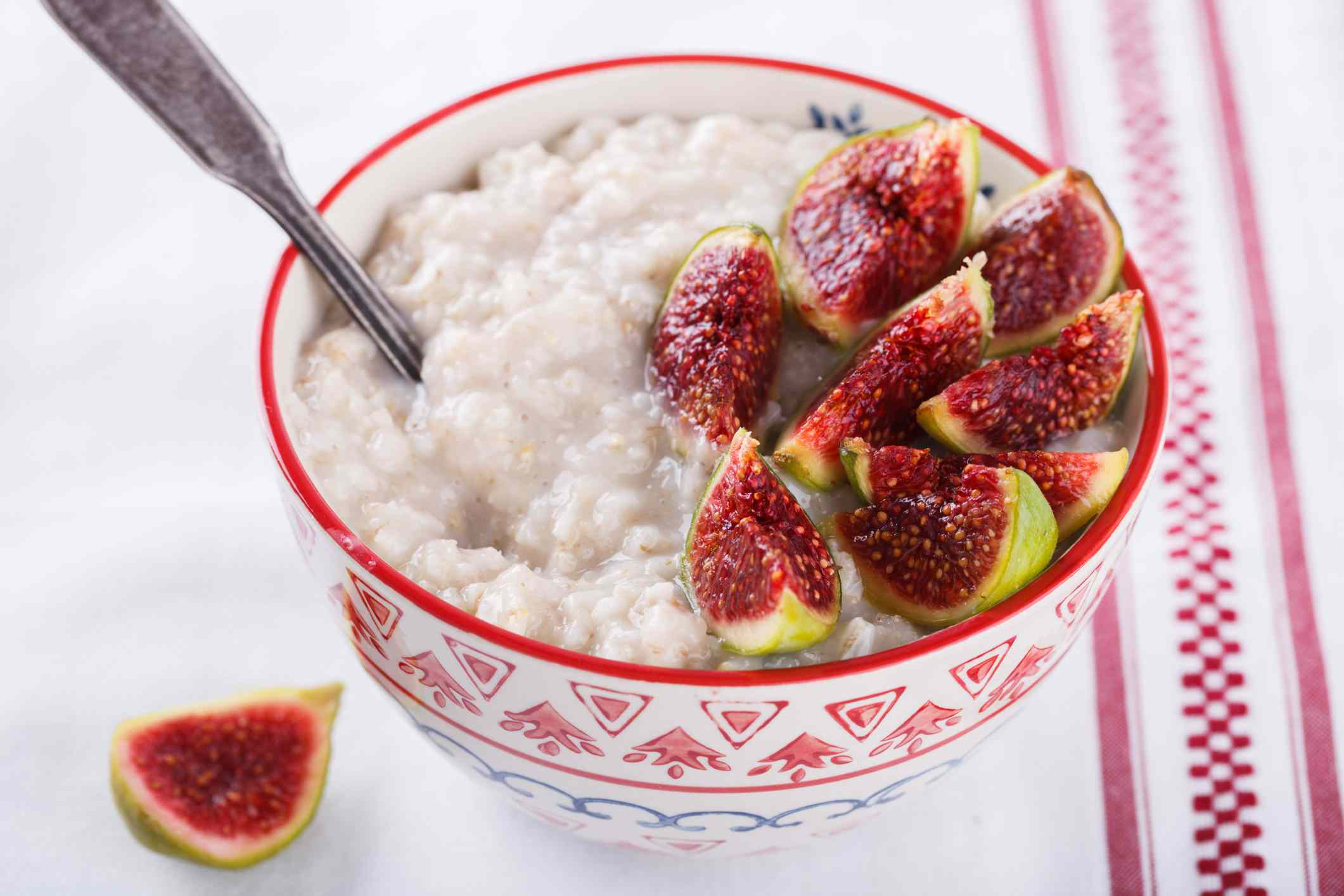 Bowl of oatmeal with fresh sliced figs