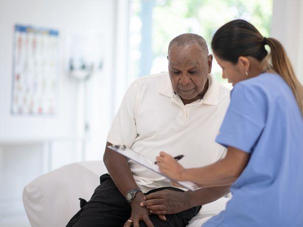 An Elderly Gentleman in His Doctors Office Receiving a Check-Up