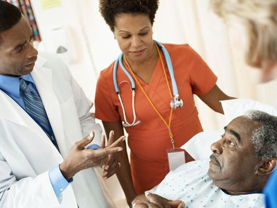 doctor talking with a patient in a hospital