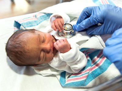 Doctor checking a newborn