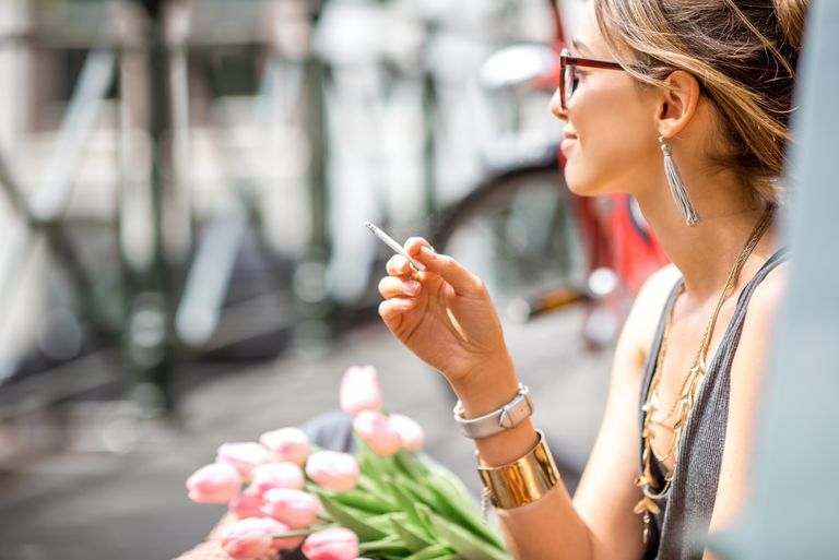 Woman smoking a joint in Amsterdam city