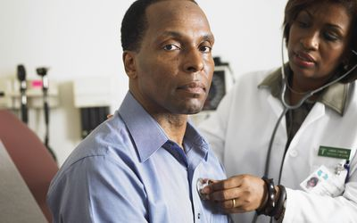 Black male being examined by doctor