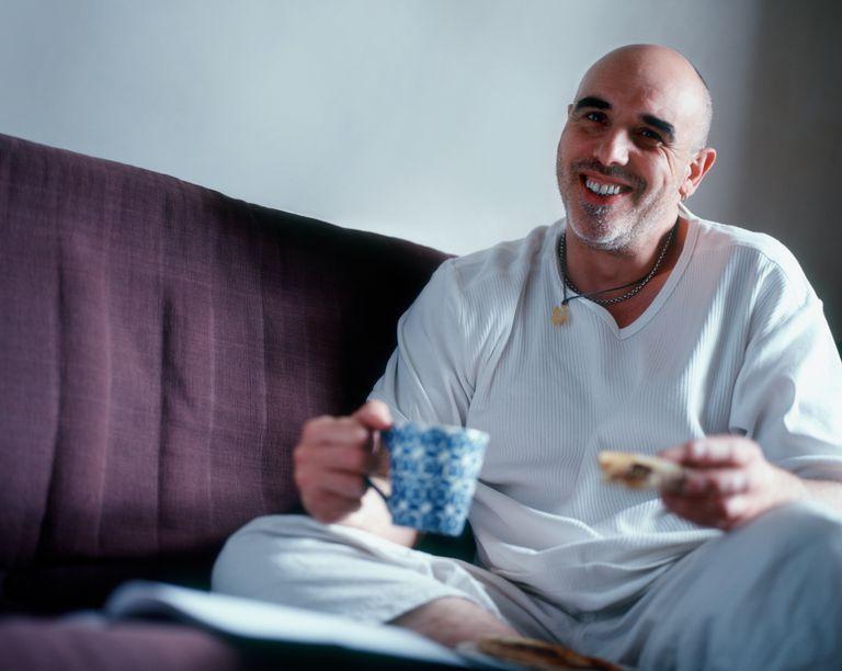 man eating toast with tea