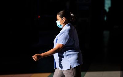 woman wearing face mask and walking
