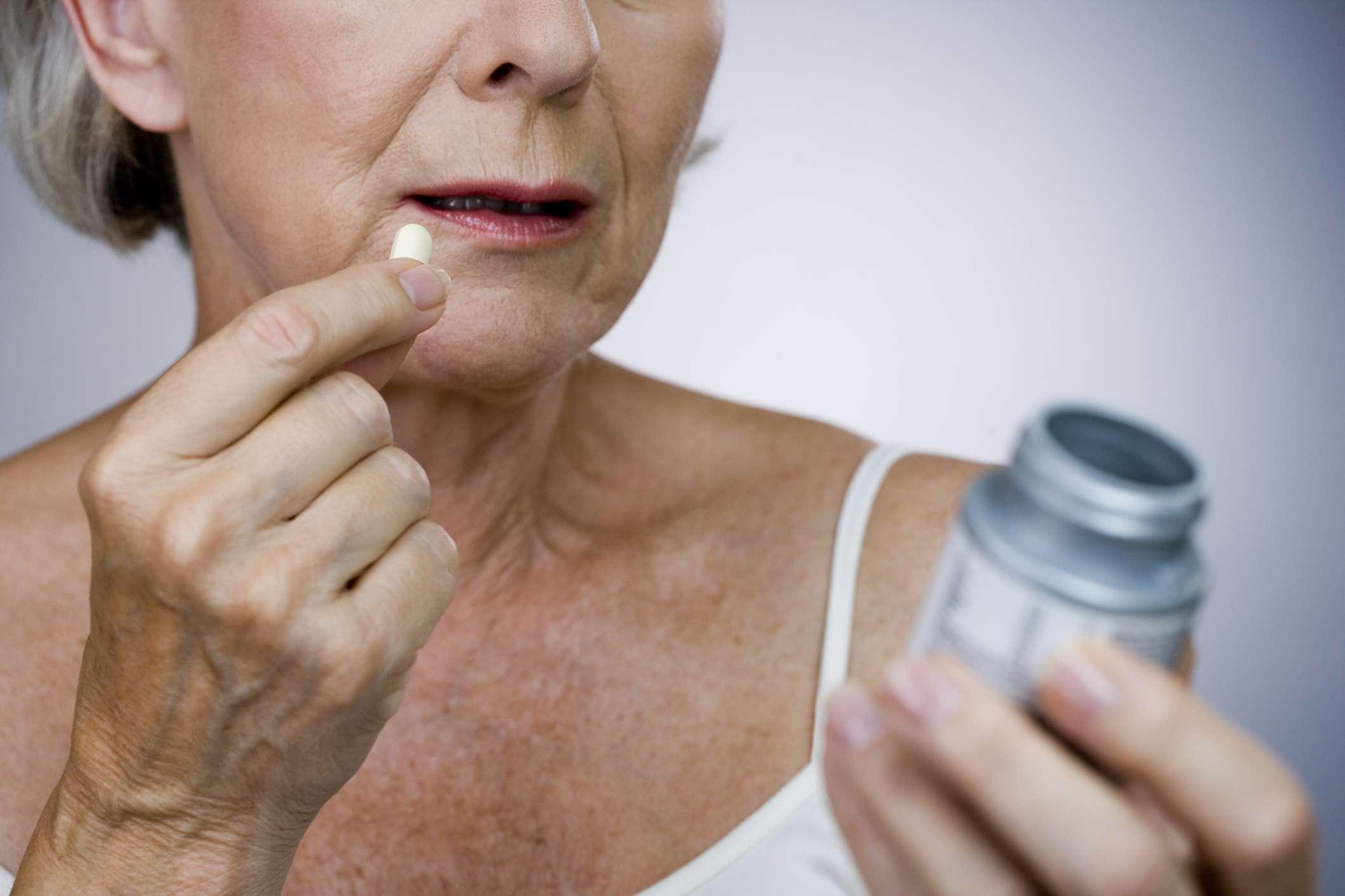 Senior woman taking salicylates.
