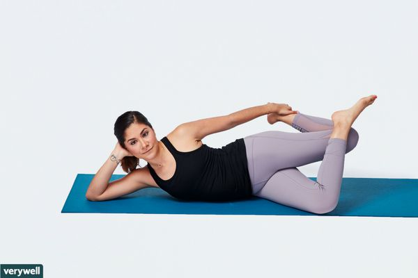 woman doing lying IT band stretch