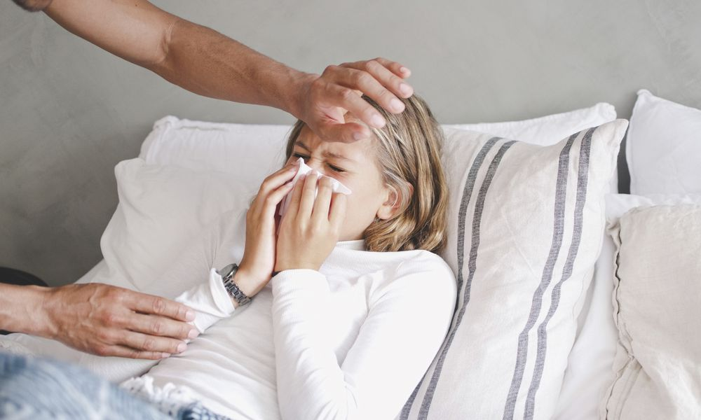 Father checking sick daughter's fever