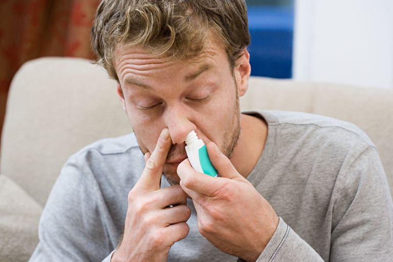Man inhaling decongestant