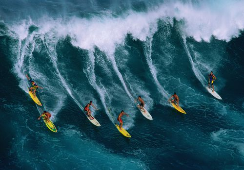 Surfers in Hawaii on a large wave