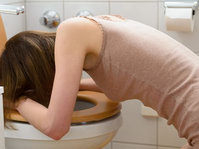Woman Vomiting
