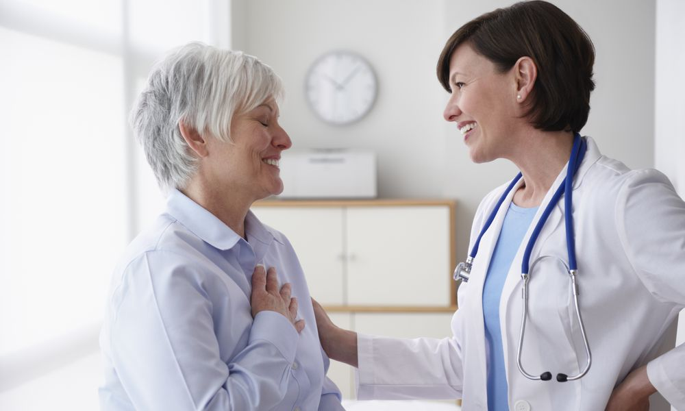 Doctor Reassuring Patient, In Examination Room