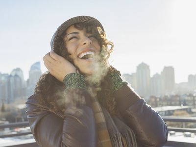 Woman laughing on patio during winter