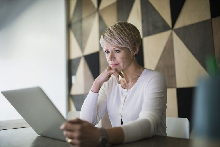 Woman of menopausal age looking at computer