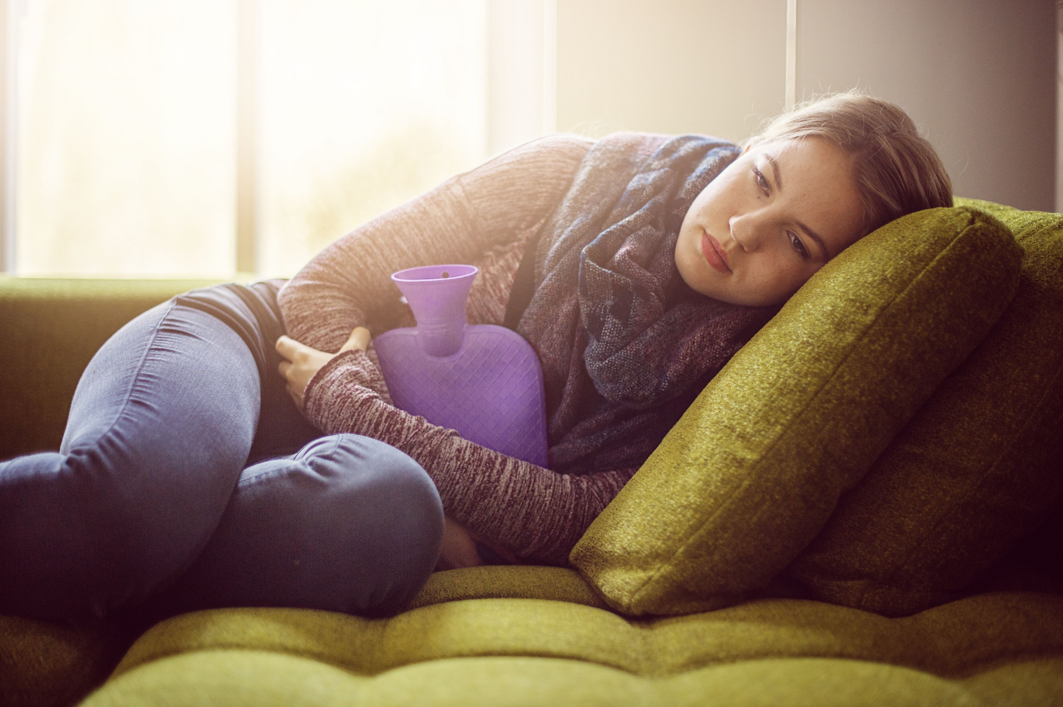 girl with hot water bottle