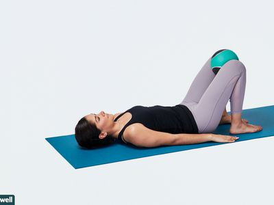 woman doing hip squeeze exercise