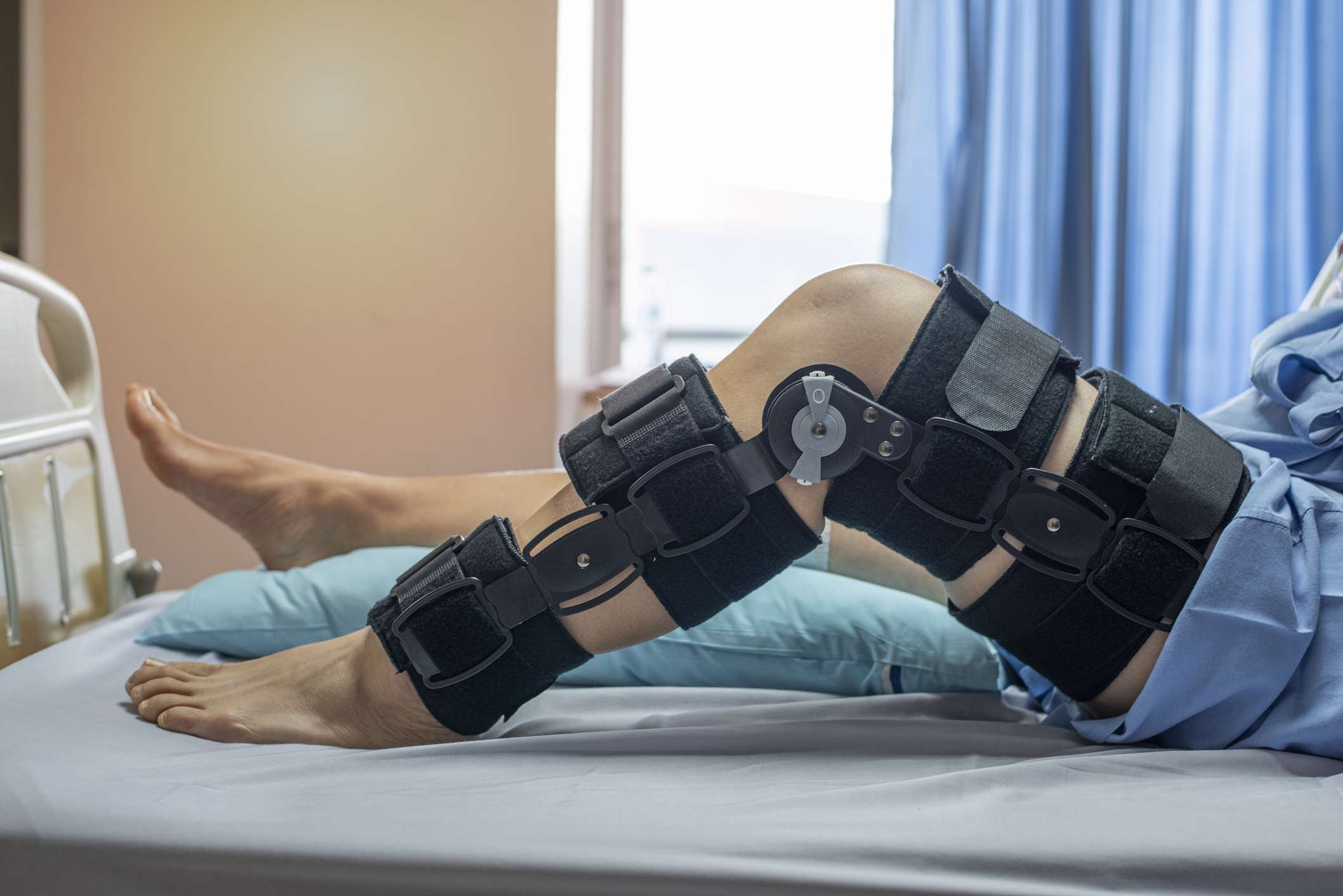 Knee brace on patient after ACL surgery