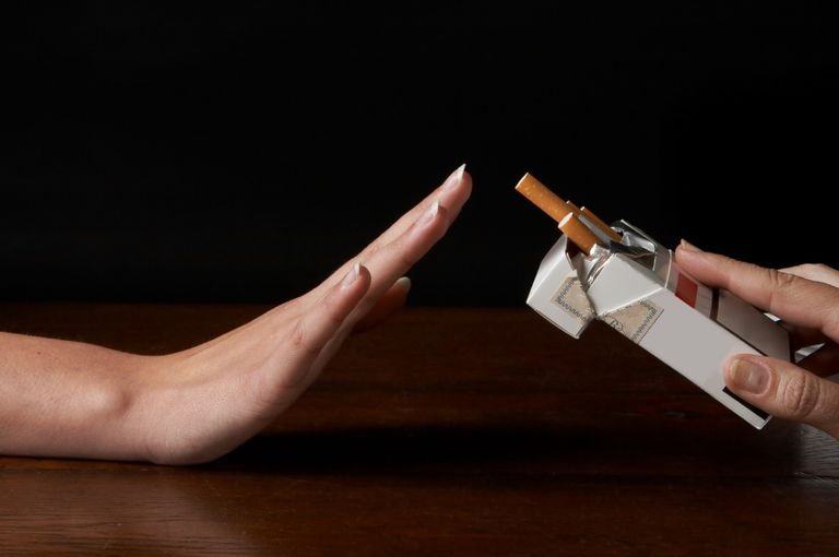 hand refusing a cigarette illustrating lung cancer symptoms differ in nonsmokers