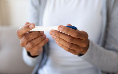 Close up of woman hold check pregnancy test.