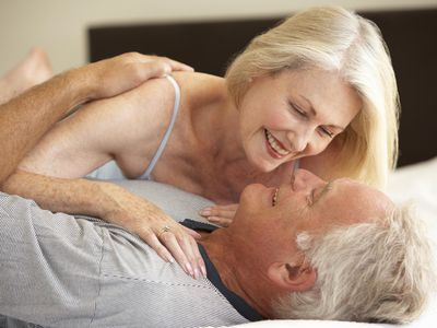 A senior couple in bed.