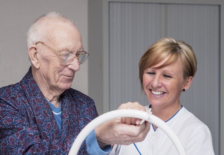 Occupational therapist working with a senior man