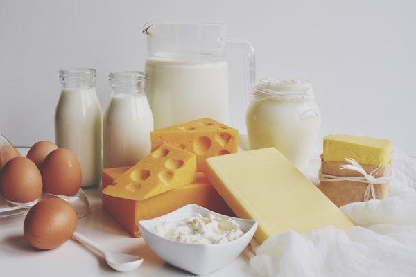 Close-Up Of Dairy Products On Table Against White Background