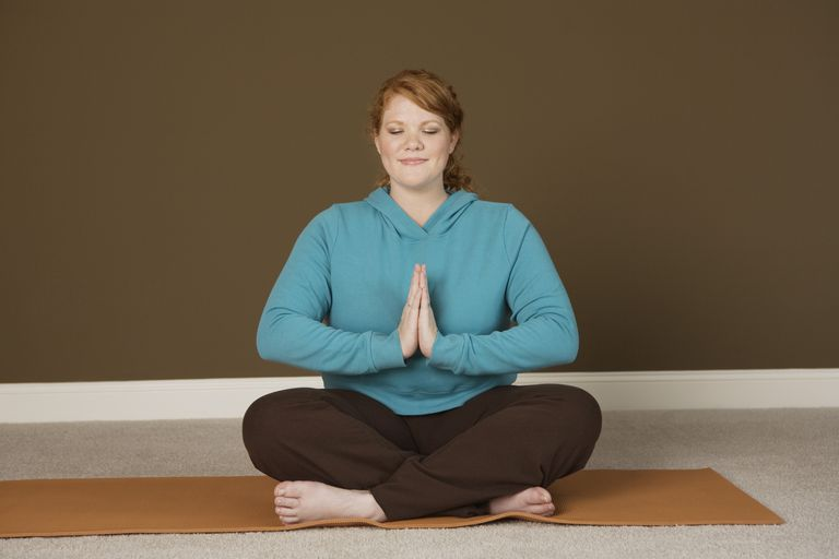 A woman in a yoga pose