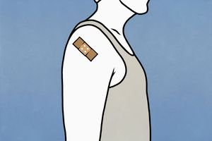 Man wearing a bandaid on arm after getting vaccinated.