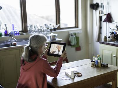 Woman at home having online consultation with doctor