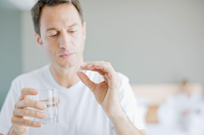 Man taking pill medication