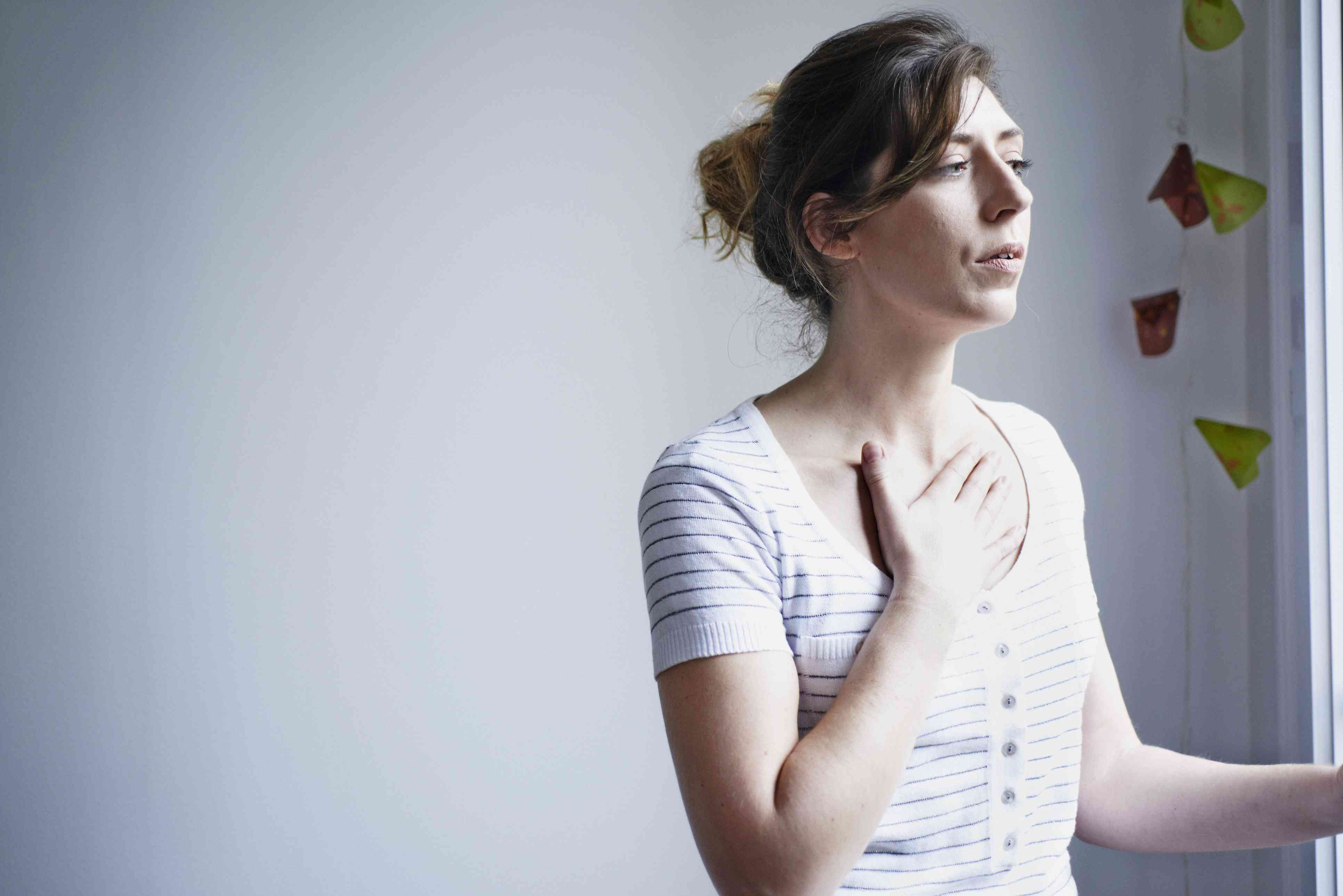 Woman with breathing difficulties. France