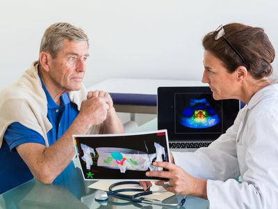 Doctor discussing prostate ultrasound scan with a patient.