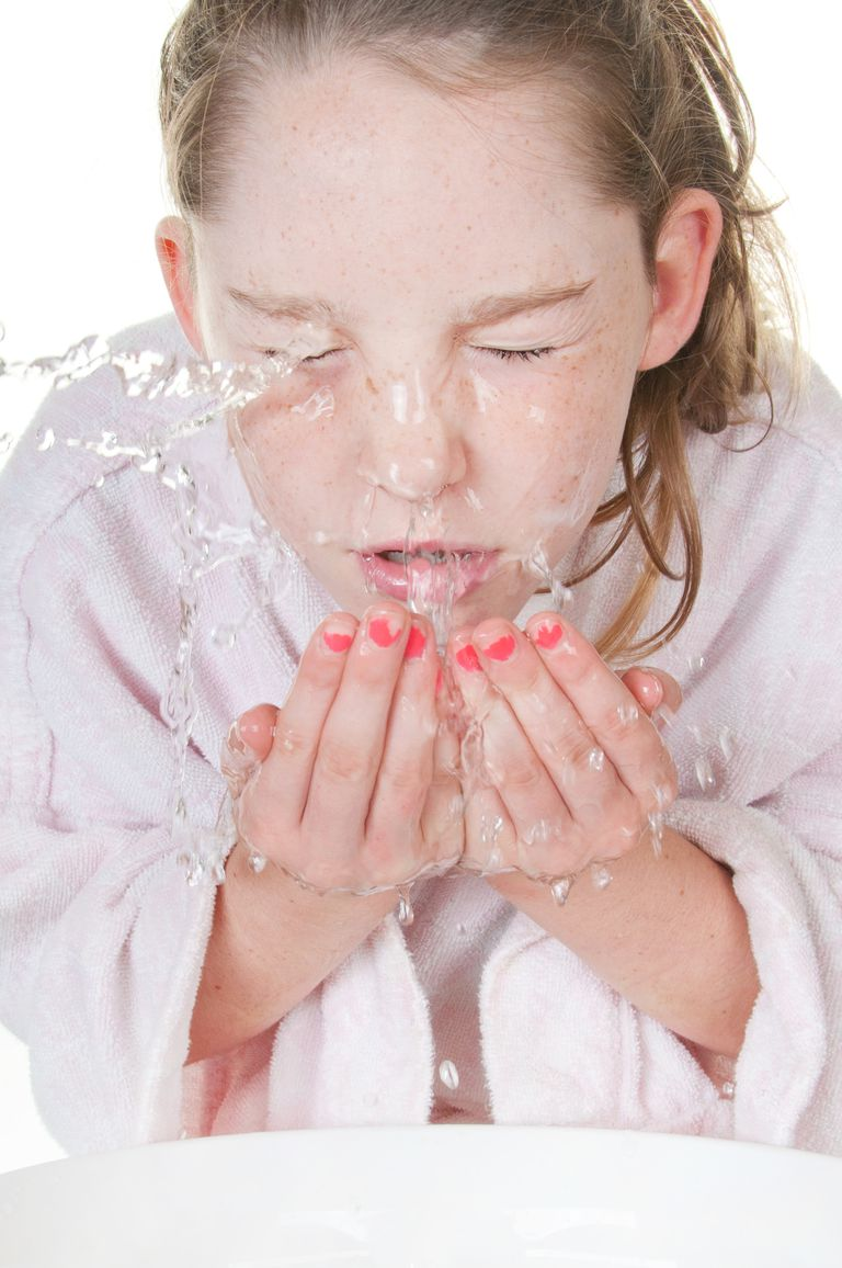 Preteen girl washing her face -- skin care tips for preteens