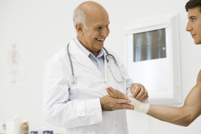 Doctor bandaging patient's wrist