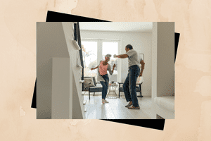Couple dancing in the living room.