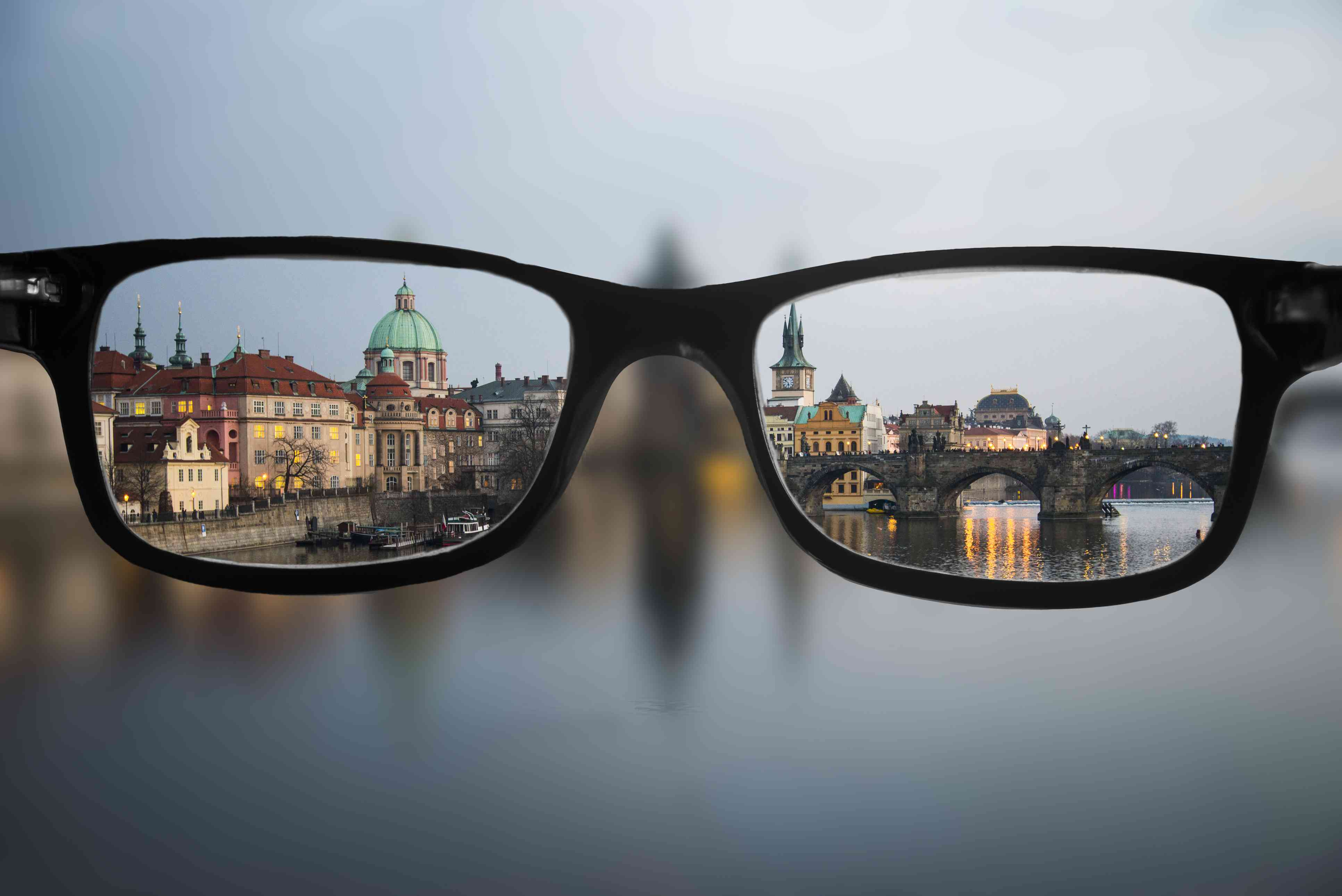 Point of view looking through a pair of eye glasses looking at a city skyline