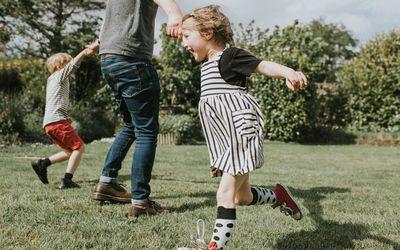 Children running in the grass.