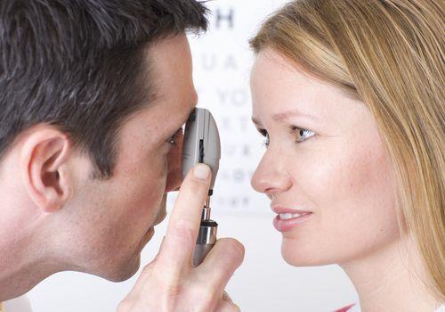Woman having and eye exam