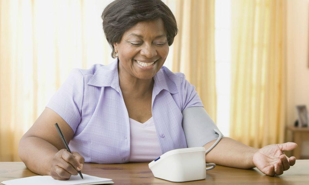 Senior woman taking own blood pressure