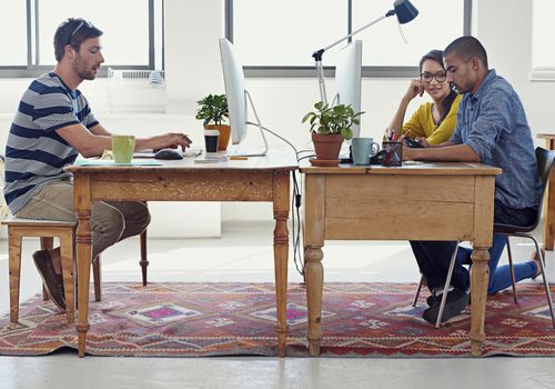 People sitting at desks in office